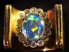 JEWERLY Elvis ring chunk of gold with blusih stone
