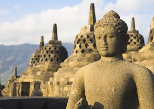 Buddha statue and stupas in Borobudur or Barabudur temple Jogjakarta Java Indonesia. It is a 9th-century Mahayana temple and the biggest Buddhist Temple in Indonesia.