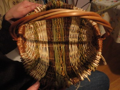 Smooth interior with no joins so if the basket is used for yarn or wool it won't snag the fibres. Beautifully woven bands of rush, rush rope, white and Dicky Meadows willow on buff frame and ribs.