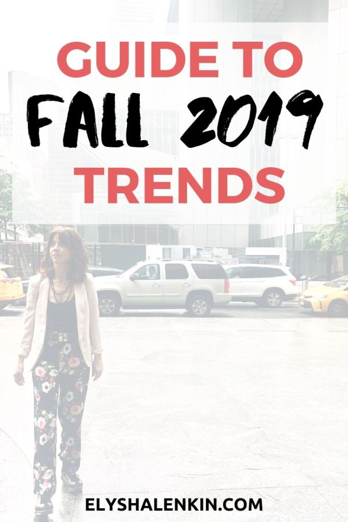 Fall 2019 trends. Women crossing the street in NYC wearing a blazer and dark floral pants.