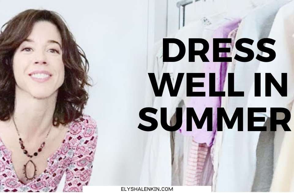 dress well in summer text overlay image of woman next to rack of clothes.