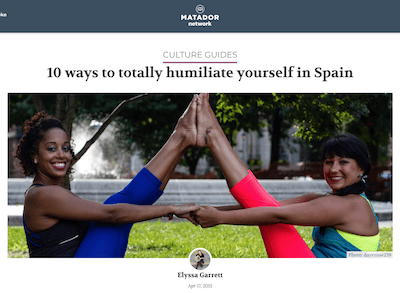 2 girls in yoga clothing sitting with their feet together and holding hands, text above image says 10 ways to totally humiliate yourself in spain