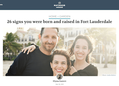a family of three poses together on a beach in front of a building, text above image reads 26 signs you were born and raised in Fort Lauderdale