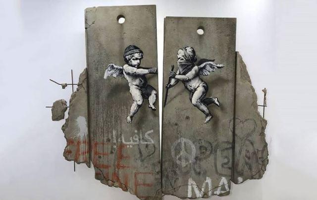 Banksy en Londres crea una barrera de separación réplica de la israelí