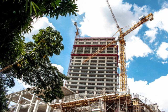 São Paulo, Brazil, December 22, 2015. Crane and Workers in the building site construction in São Paulo city