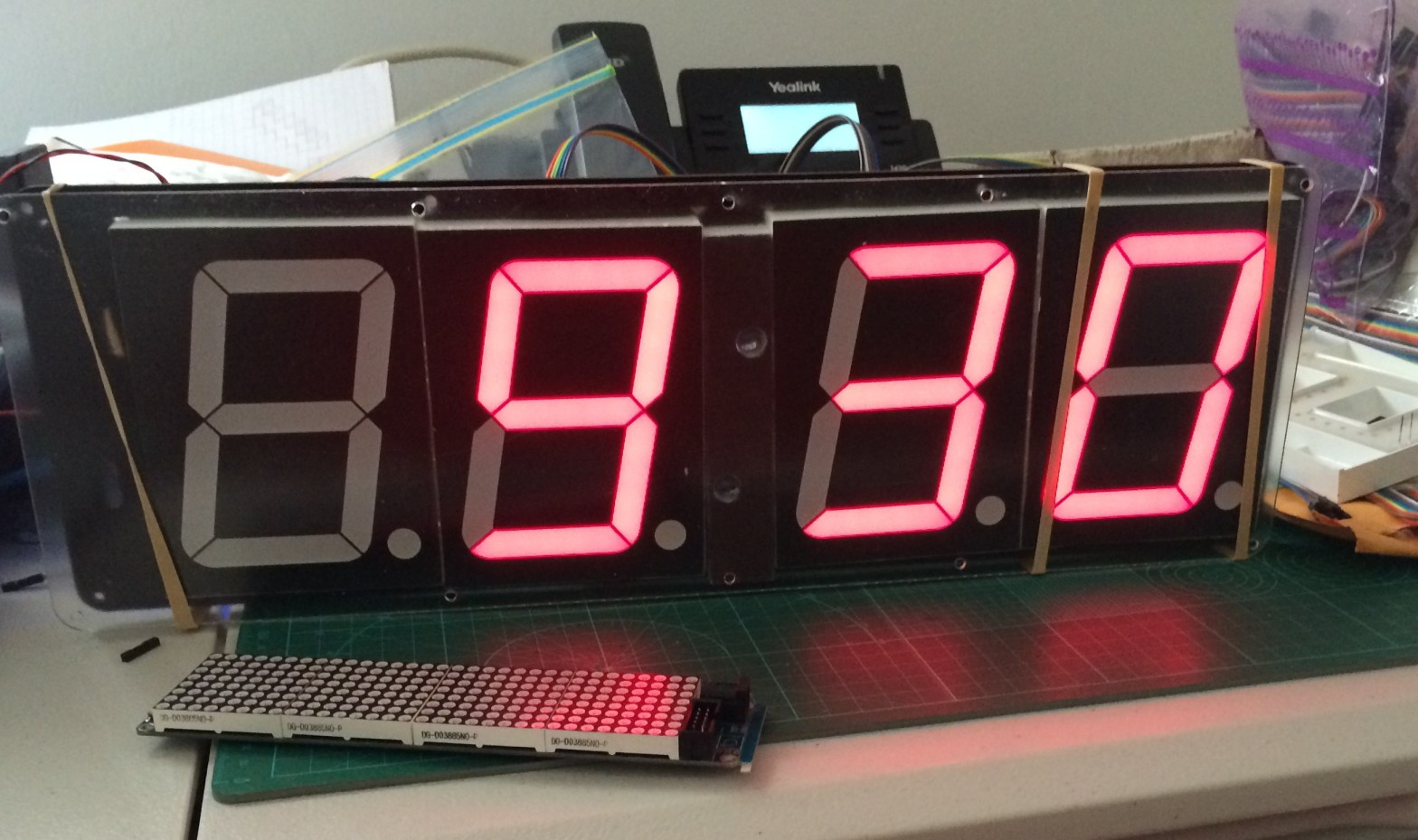 photo of clock made of 4 inch 7 segment displays showing the time of 9:30