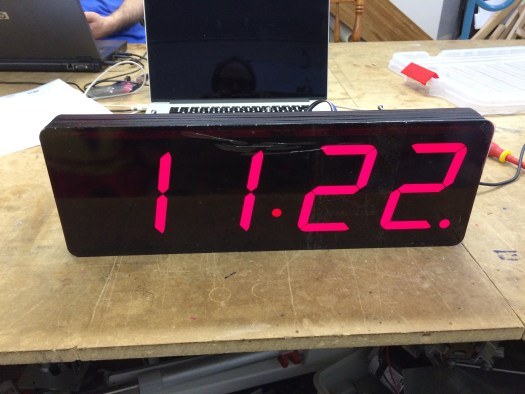 a digital clock showing the time of 11:22