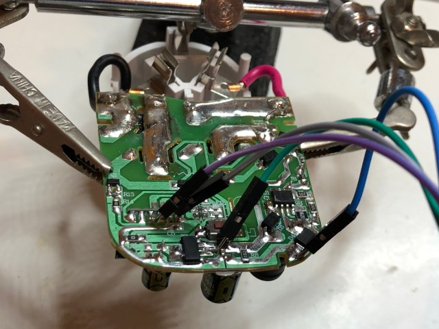 wires soldered to circuitboard to enable flashing