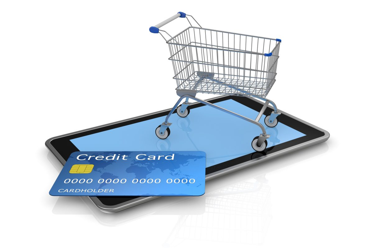 17235273 - tablet pc with a credit card and a shopping cart (3d render)