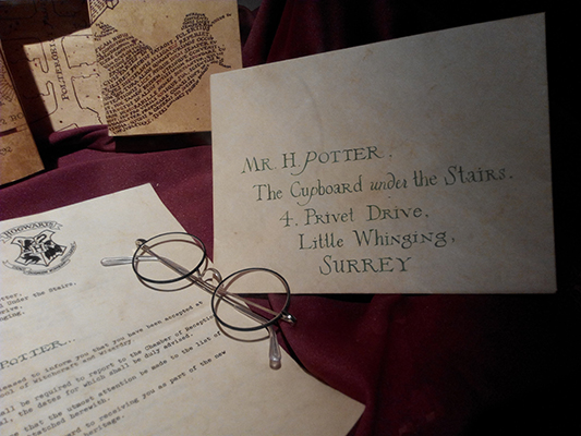 Harry Potter letter and glasses on desk