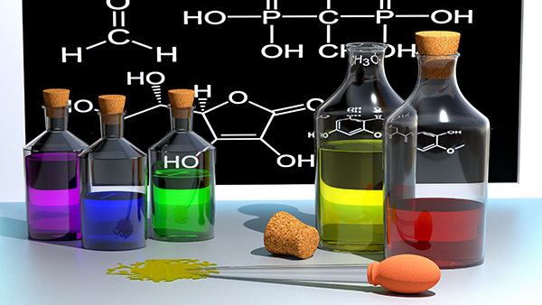 Bottles of colored liquids in front of chemical formula for organic compound