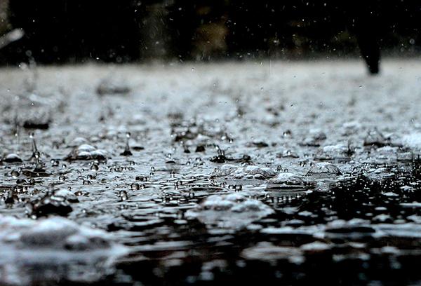 Rain splashing on concrete