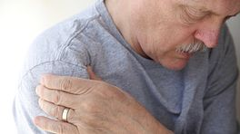 Elderly man grabbing his shoulder from chronic pain
