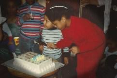 olivia cut cake for brian jr