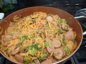 smoked sausage, cheese sauce, over sweet potato noodles