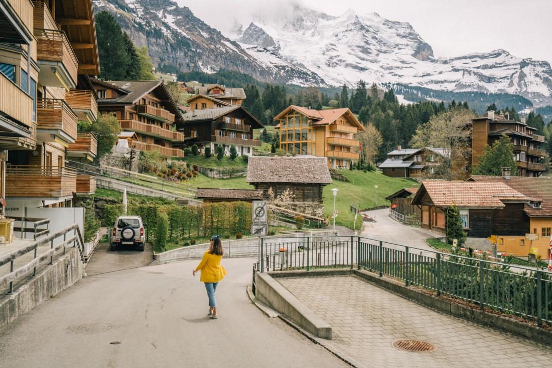 woman walking the street of Wengen in Switzerland