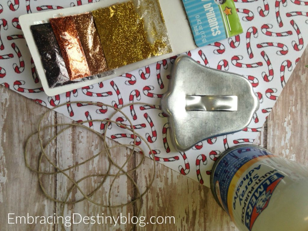 Simple supplies for the DIY Glittered Cookie Cutter Ornament. embracingdestinyblog.com