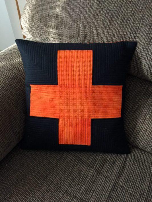 orange black plus sign pillow