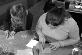 Sarah and Ava busy cutting out their designs
