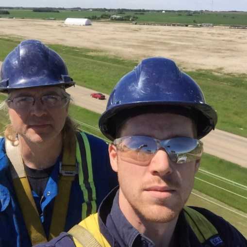 Father Son Team on top of a Bucket Elevator