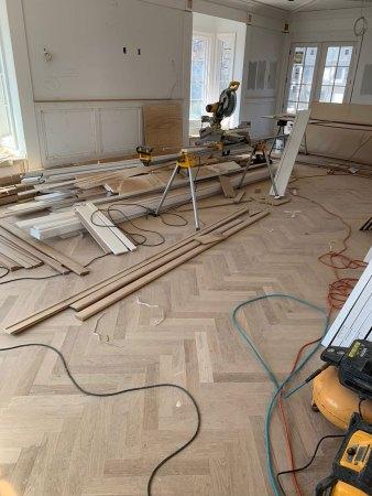 custom herringbone hardwood floor installation - in progress