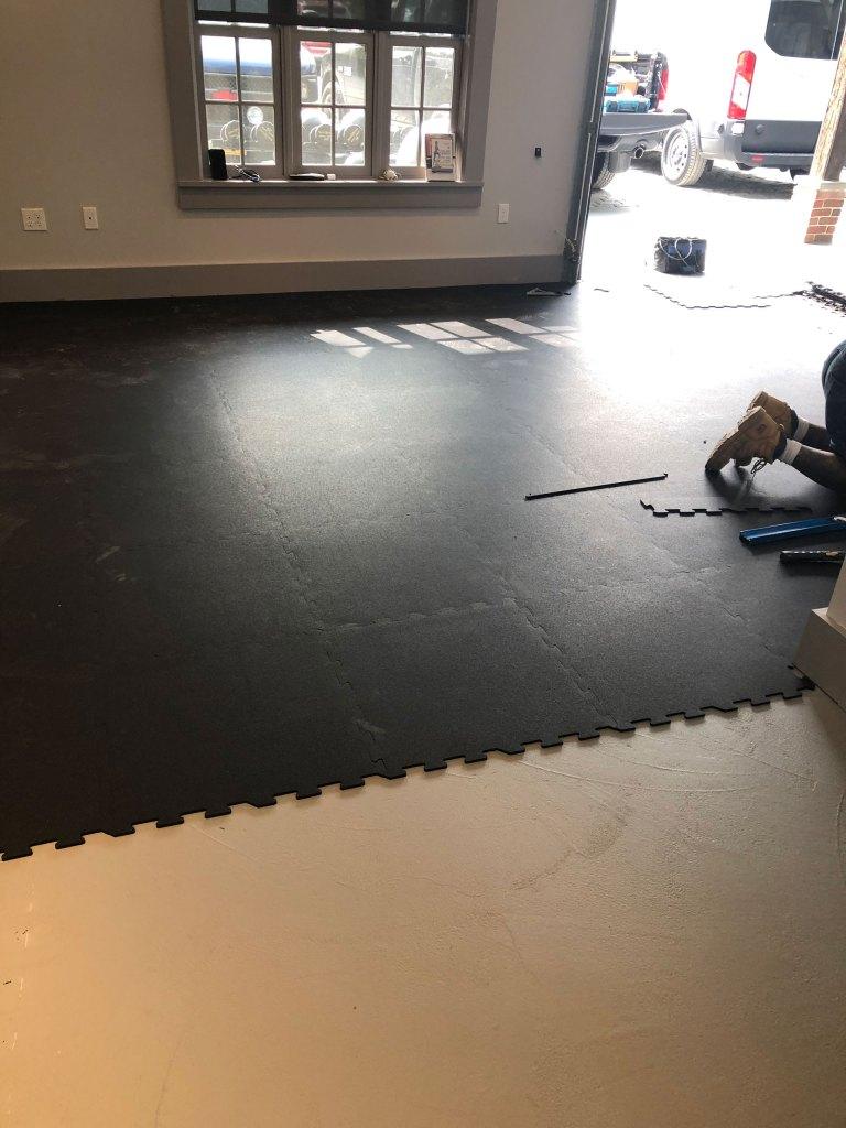 Rubber gym floor installation with interlocking tiles