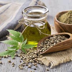 Hemp seed oil next to a scoop filled with hemp seeds | Ingredients