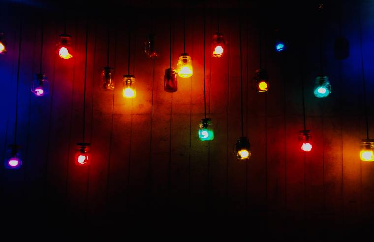 A series of colourful festoon lights against a dark backdrop