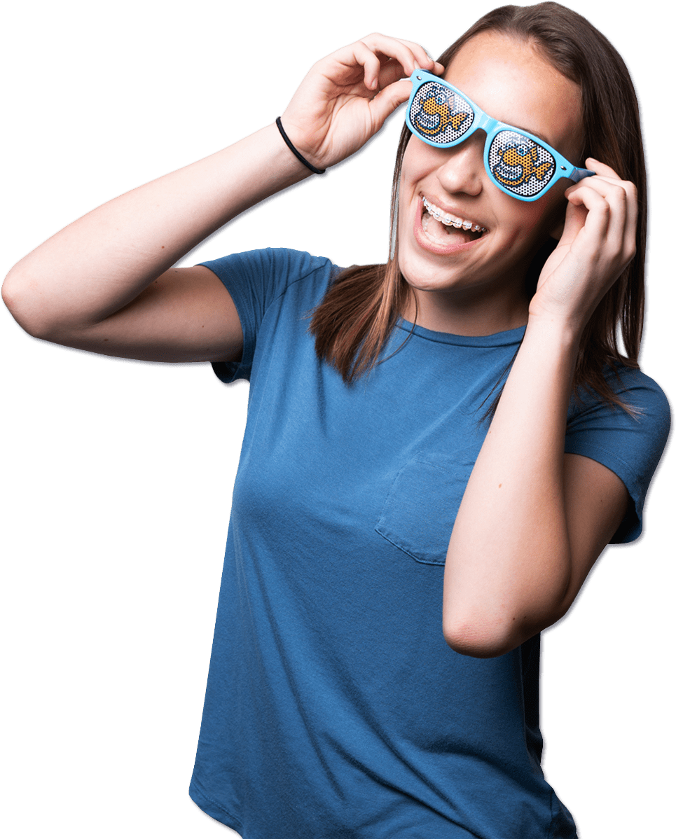 Young teenage girl blue shirt, blue shirt sunglasses Fishbein Orthodontics