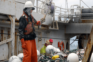 Commercial Fisherman with ALERT2 MOB Device