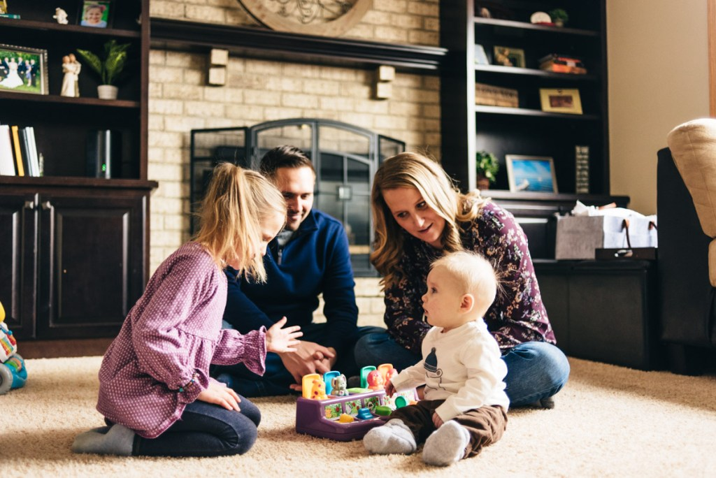 Lifestyle of family playing in home