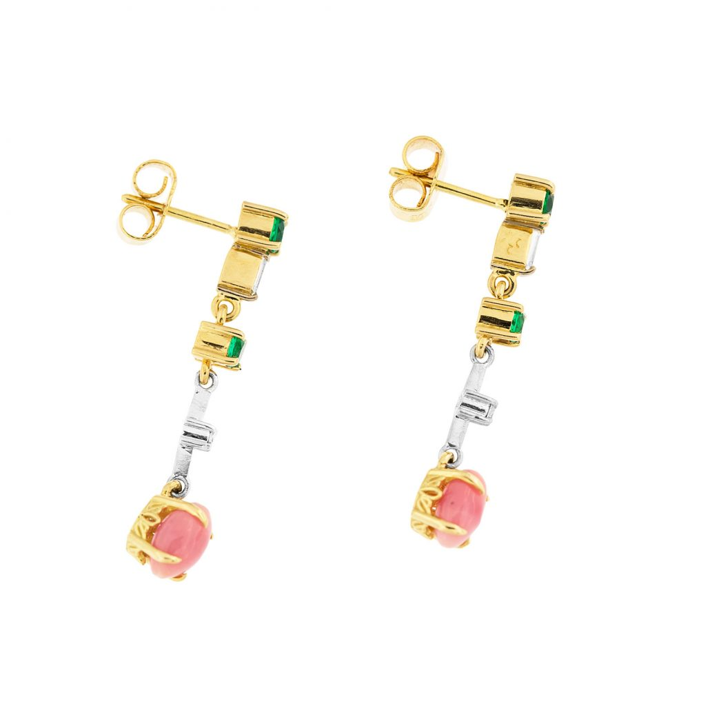Dangle conch pearl earrings featuring conch pearls and