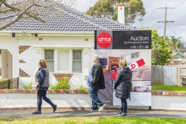 Negative gearing, similar to empty nesters sitting on larger properties, is one of the factors leading to a shortage of supply for Australian homebuyers. This image shows people looking longingly at a house they must've just missed out on. Available at: https://theconversation.com/policycheck-negative-gearing-reform-58404