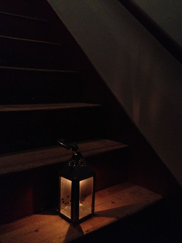 A lantern lights the stairs next to Jackson's room