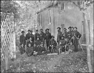 Alfred Pleasonton and his staff. This photograph was taken in October 1863 in Warrenton, Virginia. Pleasonton is seated in the center of the photgraph. George Yates is standing, second from left.
