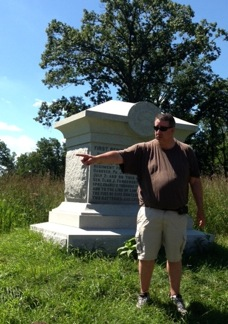 Eric Wittenberg discusses Farnsworth's Charge in front of the monument.