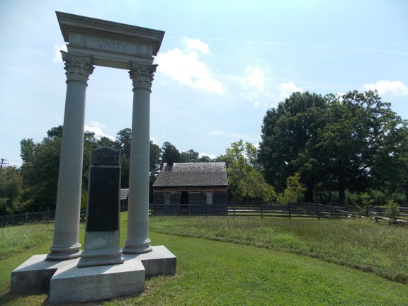 The Unity Monument with the Bennett House (Place) in the background.