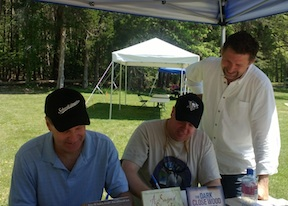 """Don Pfanz (left) and Bert Dunkerly (center) sign copies of their new book """"No Turning Back"""" while I make like Grant hovering over Meade's shoulder."""