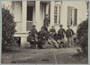 James Wilson, seated in the center facing the viewer's right, with his staff at City Point Virginia in 1864.  Courtesy of the Library of Congress