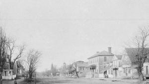 The c.1890 image of the Duke of Gloucester (Main) Street in Williamsburg. This image which is in the Colonial Williamsburg Foundation collections was taken facing west about half way between the current Capitol building and the College of William and Mary.