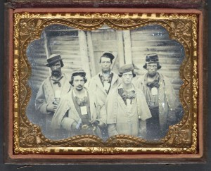 "The prisoner second from right sports a hat with a similar style. Entitled, ""Five unidentified prisoners of war in Confederate uniform in front of their barracks at Camp Douglas Prison, Chicago, Illinois."" Courtesy of the Library of Congress."