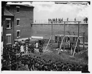 The four defendants hanged in the grounds of the Washington Arsenal. From left to right: Mary Surratt, Lewis Powell, David Herold, George Atzerodt.  (Library of Congress)