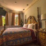 Bedroom in the Roman Dynasty Suite at Chateau Avalon