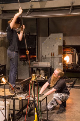 Photo of a pair of glass artists and glass furnace