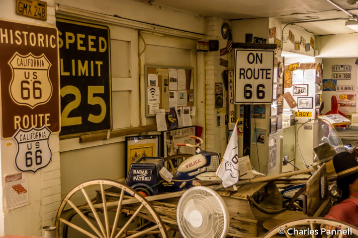 Signs, a buckboard and toy cars in the Barstow Route 66 Mother Road Museum