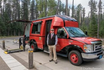 Photo of Glacier National Park's accessible Red Bus with driver