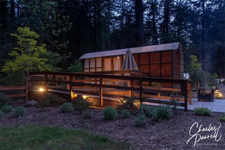 This romantic retreat in the Sonoma redwoods features a custom made Redwood Suite camping trailer with a small galley and a roll-in shower. Pack along some s'more makings and enjoy the evening on your own private deck which overlooks the creek. A Redwood Retreat to Remember