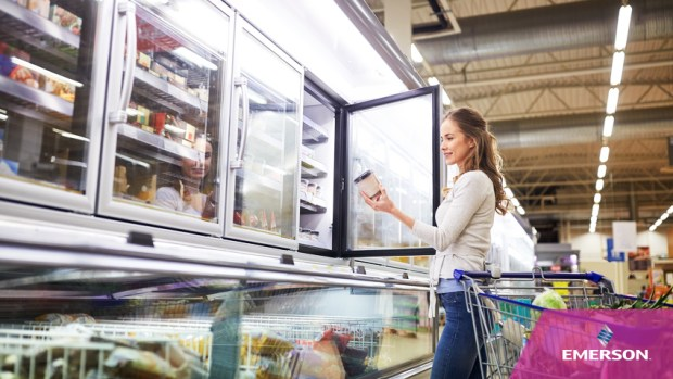 woman choosing ice cream at grocery store freezer