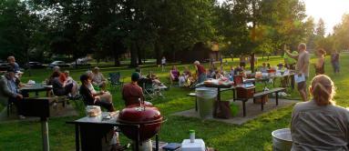 An informal neighborhood council meeting as the sun sets