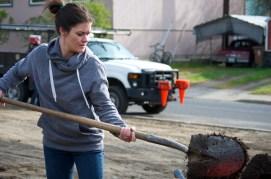 Jackie shovels some compost.